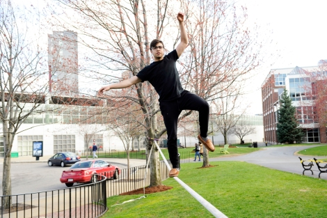 04/24/15 - BOSTON, MA. -  Doug Pagani, S'16, used the slackline on Centennial Common at Northeastern University on April 24, 2014. Staff Photo: Matthew Modoono/Northeastern University